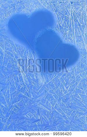 Blue Hearts Silhouettes On The Frozen Winter Window