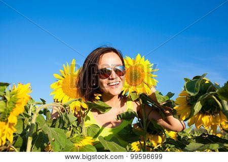 Young Beautiful Woman Girl On Background Of Sunflower Field