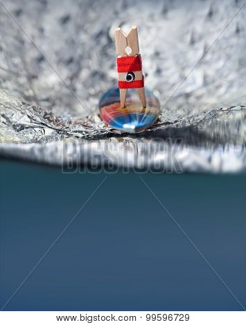 Surfer Girl In Red Bikini On A Wave. Abstract Sport Concept With Surfing Clothespin.