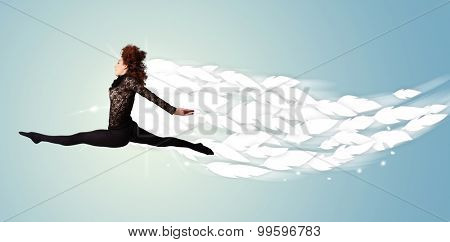 Healthy young woman jumping with feathers around her concept on bright background