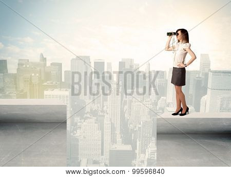 Businesswoman standing on the edge of rooftop with city background
