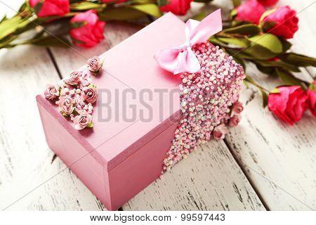Beautiful handmade casket with flowers, close up