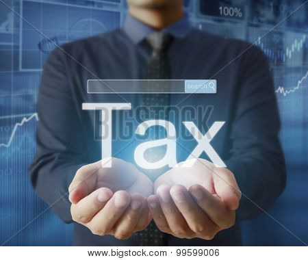 businessman tax in a hand