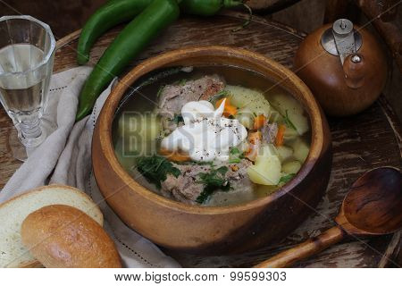 Wine-glass Of Vodka And Stewed Meat With A Potato, Vegetables And Greens