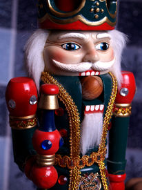 foto of tchaikovsky  - a closeup of a well decorated nutcracker king with a hazelnut in his mouth - JPG