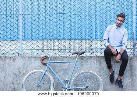 Man Sitting On The Wall