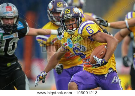 ST. POELTEN, AUSTRIA - JULY 26, 2014: WR Laurinho Walch (#6 Vikings) runs with the ball during Austrian Bowl XXX.