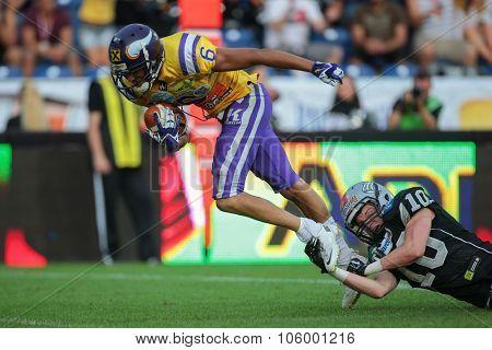 ST. POELTEN, AUSTRIA - JULY 26, 2014: LB Sandro Platzgummer (#10 Raiders) tackles WR Laurinho Walch (#6 Vikings) during Austrian Bowl XXX.