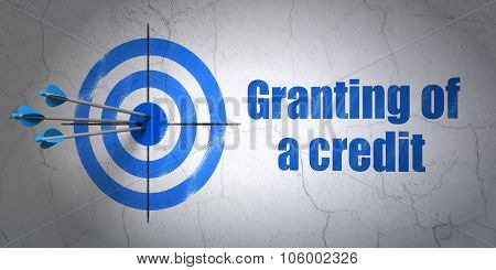 Money concept: target and Granting of A credit on wall background