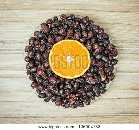 Dried Rosehips And Sliced Orange Arranged In The Bowl, Healthy Lifestyle