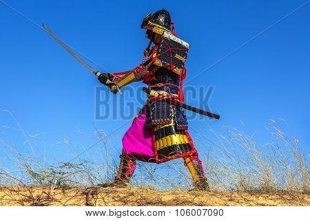 Samurai In Ancient Armor Sword Attack