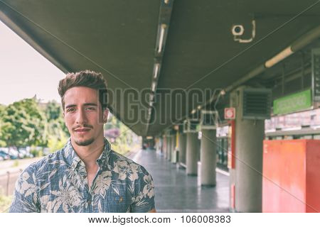 Young Handsome Man Posing In A Metro Station