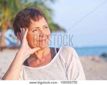 Portrait Of A Beautiful Middle-aged Woman On The Beach