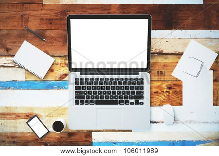 Blank Laptop On A Vintage Wooden Surface With A Cell Phone, Cup Of Coffee And Accessories, Mock Up