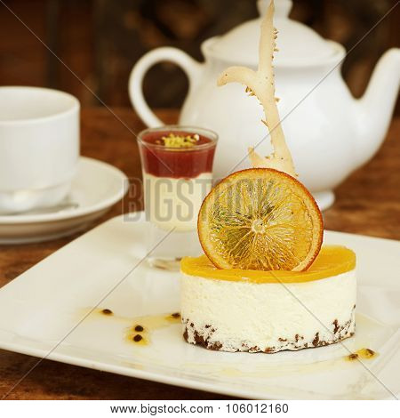 Orange Cheesecake On A White Plate