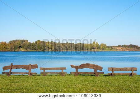 Four Wooden Benches At The Lake