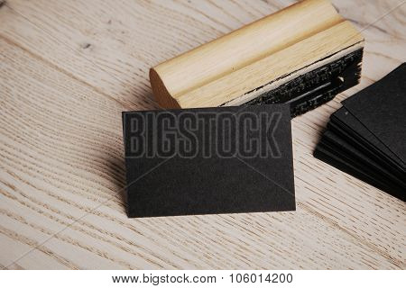 Black business card. Set of blank office elements on the wooden background.