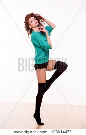 Sexy dancer posing in photo studio