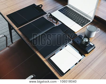 Set of generic design laptop on the wooden table and office elements. 3D rendering