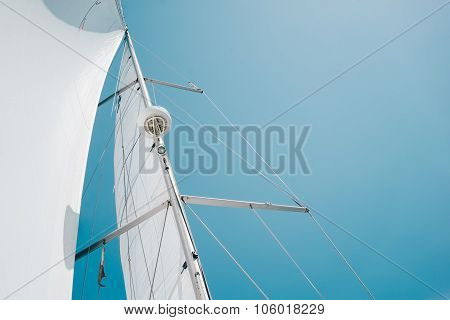 Big white sail of a sailing boat against the sky. Horizontal
