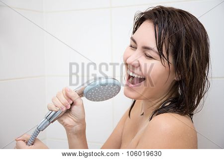 Portrait Of Happy Woman Singing In Shower