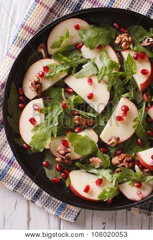 Apple Salad With Pomegranate And Arugula Close-up. Vertical Top View
