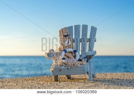 tropical beach with a sun-lounger facing the blue sea at dawn - shallow DOF