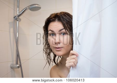 Cute Scared Woman Hiding Behind Shower Curtain