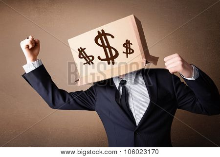Businessman standing and gesturing with a cardboard box on his head with dollar signs