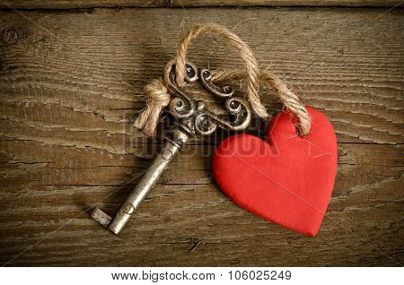 Handmade Heart With Key Together Lying On A Wooden  Board.top View