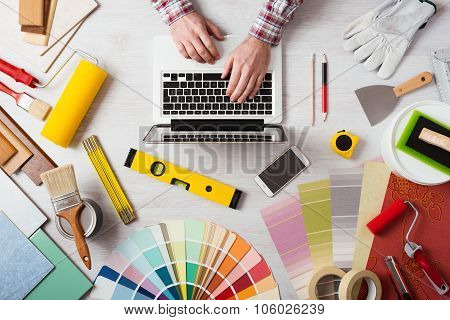 Professional Decorator Working At Desk