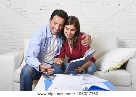 Attractive Couple Accounting Debt At Home Couch Happy In Financial Success And Wealth
