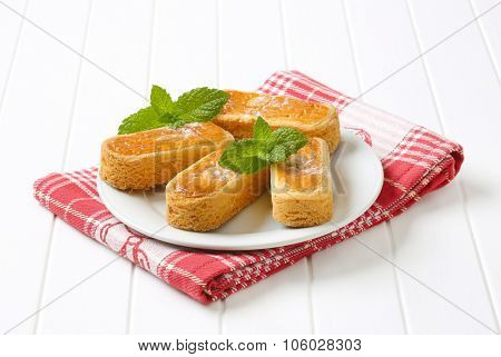 plate of caramel biscuits on checkered dishtowel