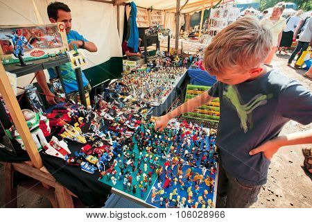 Boy Wants To Buy The Small Toy Figures Of Lego Designer