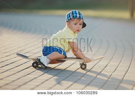 cute little boy with skateboard outdoors