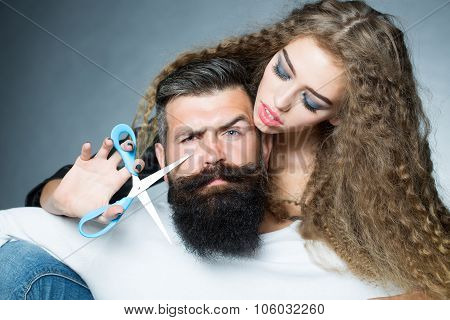 Woman Cutting Man's Beard