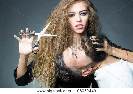 Sensual Couple Posing With Scissors