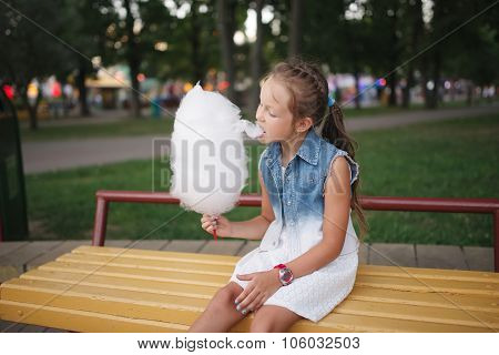 cute little girl with cotton candy in park