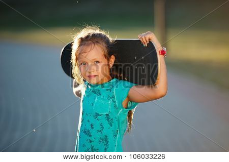 cute little girl with skateboard