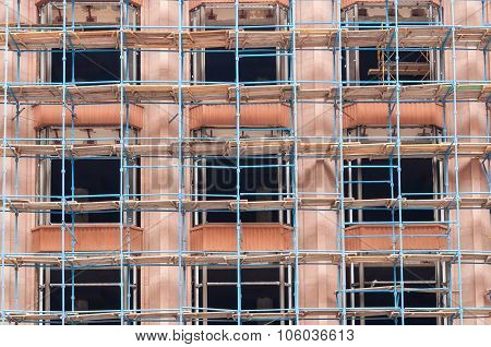 Scaffold or scaffolding, Building under construction, engineering and development. Reconstruction ba