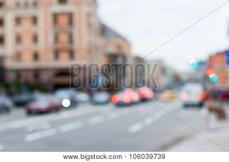 Blurred Cars in traffic at an intersection, city background