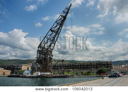 Old Crane In Port In Trieste,italy