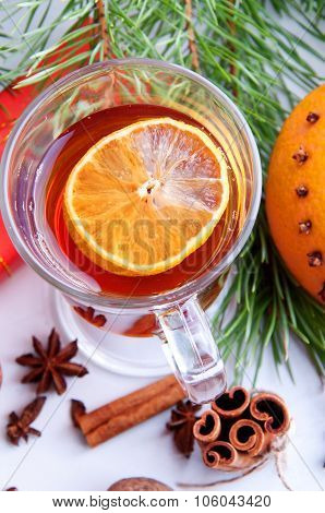 Hot Winter Drinks. Black Tea With Lemon, Cinnamon, Star Anise Seeds And Orange