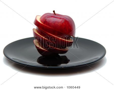 Sliced Apple On Black Plate Two