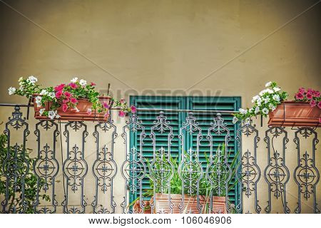 Close Up Of A Balcony With Flower Pots In Tuscany