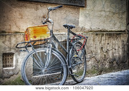 Old Bike With Wooden Case Against A Wall In Florence