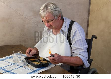 Elderly man in nursing home disliking his ready made dinner