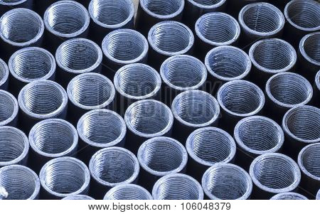 A Lot Of Short Metal Pipes With External Thread