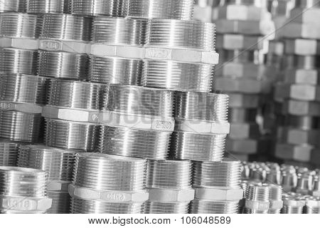 Group of metal threaded connection parts closeup. Silver.