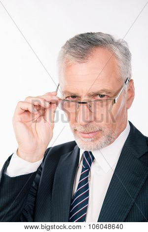 Handsome Intelligent  Old Man In Business Suit  Holding Glasses And Ponder